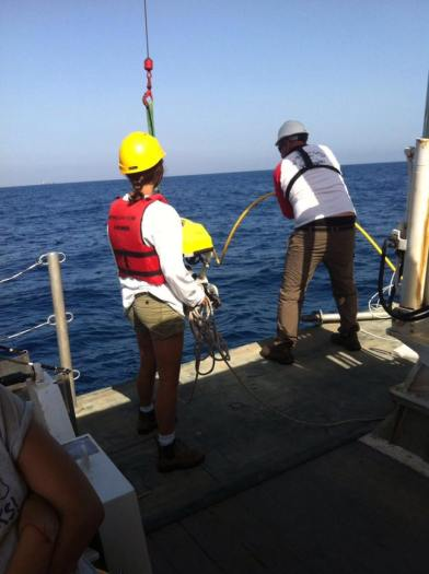 Placing the ROV in the water from the stern of the research vessel.