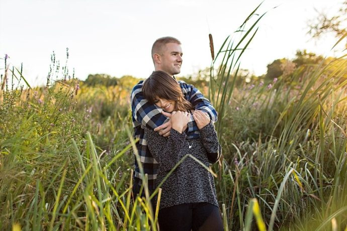 A man holds his fiancee in his arms in Newburyport, Massachusetts.