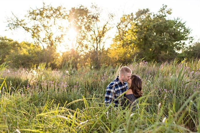 A couple kisses in a field in Newburyport, Massachusetts.