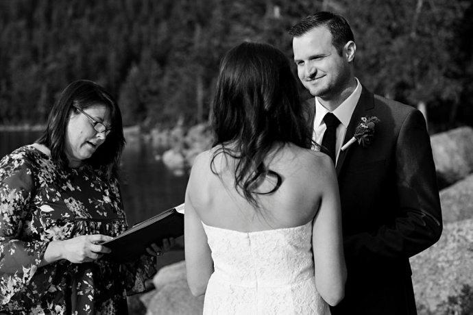 Groom smiling at his bride at Jordan Pond.