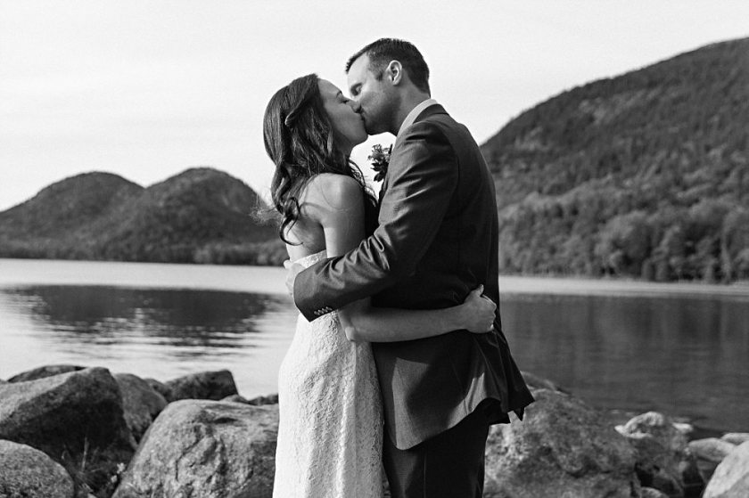 Bride and groom's first kiss at Jordan Pond in Acadia National Park.