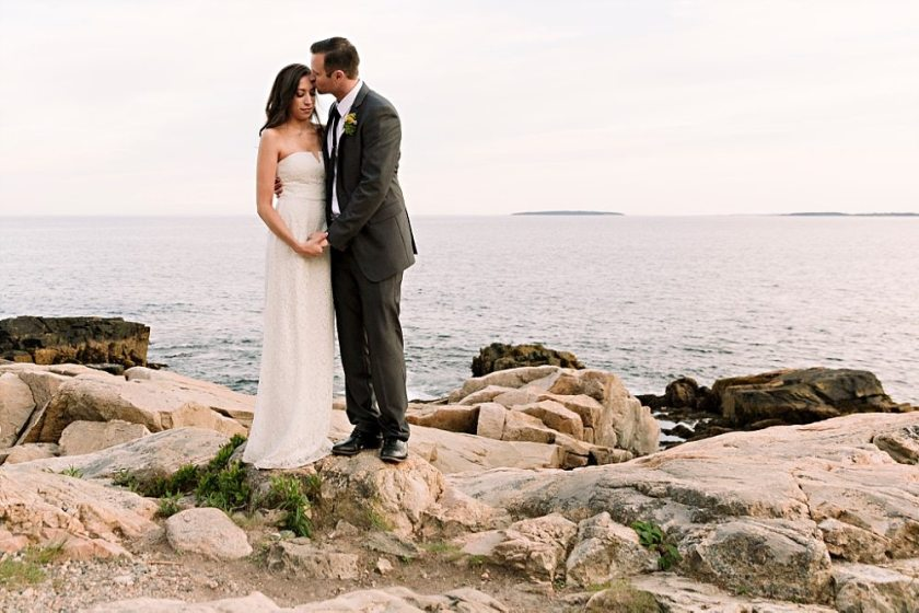 Bride and groom having a sweet moment in Acadia National Park.