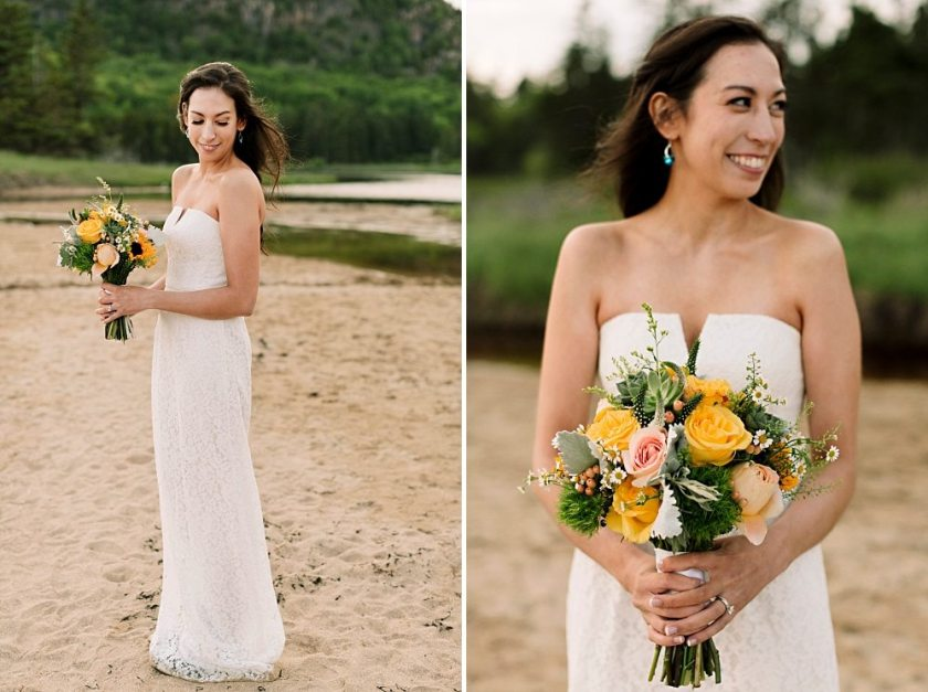Bride and her bouquet at Sand Beach in Acadia National Park.