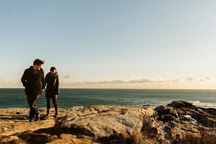 couple walking on cliff