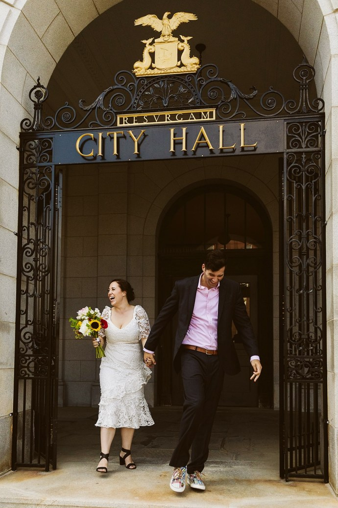 Bride and groom exiting city hall after Portland Maine elopement