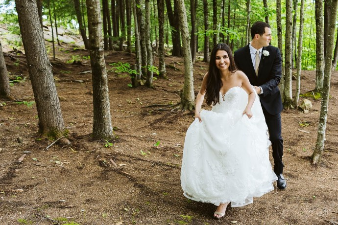 bride and groom walking through woods at Granite Ridge Estate & Barn wedding