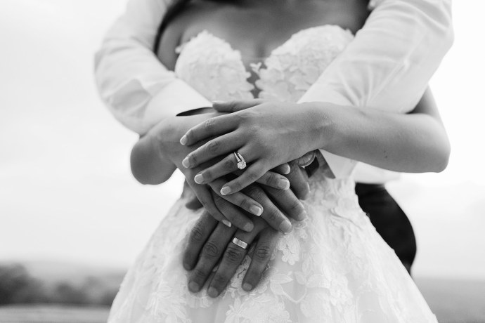 bride and groom wearing wedding rings