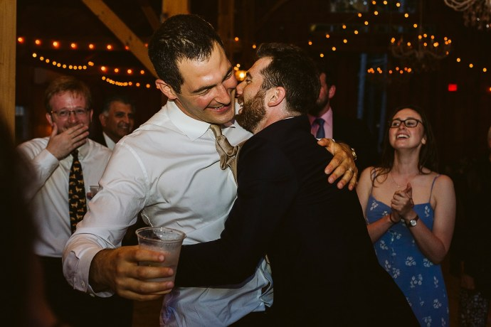 groom dances with friend