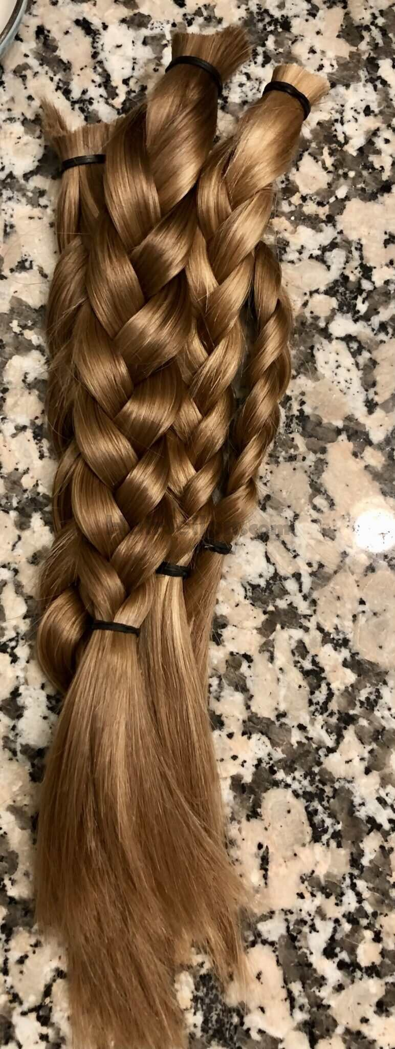 11.5 - 12.5 inches of dark blond virgin female hair.