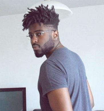 16 Must-Try Hairstyles For Black Men | Mid Fade with Medium-Length Dreads | Hairstyleonpoint.com