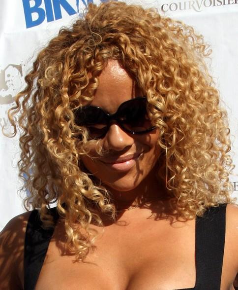 Christina Brave Williams medium curly hairstyle