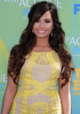 Demi Lovato Layered Half Up Half Down Hairstyle with Bangs