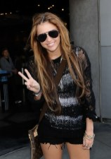 Miley Cyrus Layered Hairstyle with tiny Braids