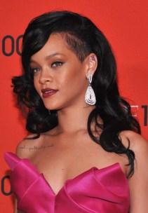 Rihanna Long Hairstyles: Black Wavy Hairstyle with Bangs