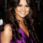 Selena Gomez Long Curly Hairstyles: Sexy Curls with Bangs
