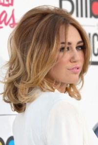 Side View of Miley Cyrus Medium Ombre Hair voluminous bob