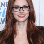 Alyssa Campanella Glossy Long Auburn Hairstyle for Winter