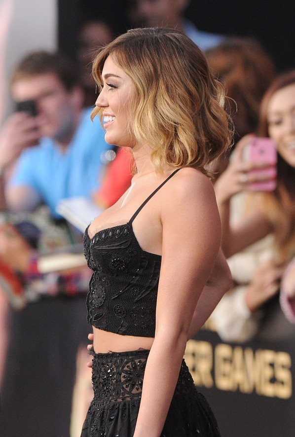 Side View of Miley Cyrus Medium Layered Ombre Hairstyle