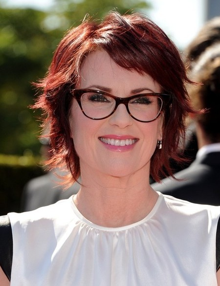 Megan Mullally Layered Short Red Hairstyle for Thick Hair