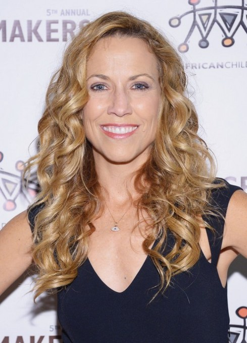 Sheryl Crow Soft Curly Hairstyle without Bangs