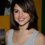 Selena Gomez short straight bob haircut with side swept bangs for teenagers