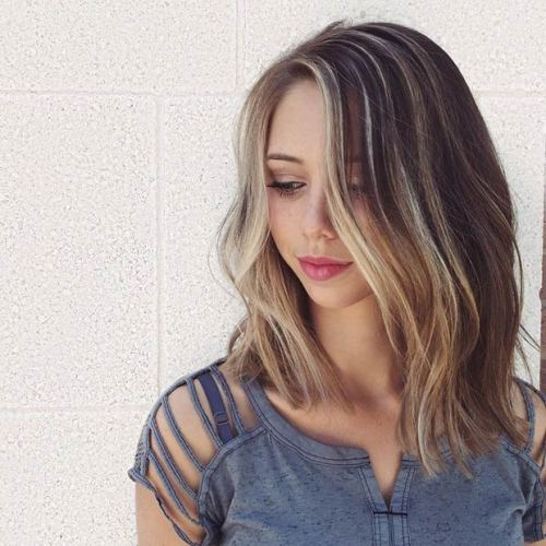 brown long bob hairstyle with blonde highlights