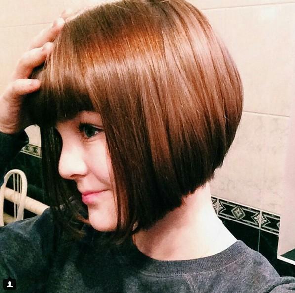 Cute short bob haircut with blunt bangs
