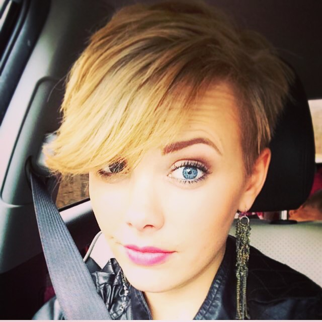 blonde pixie cut with long bangs
