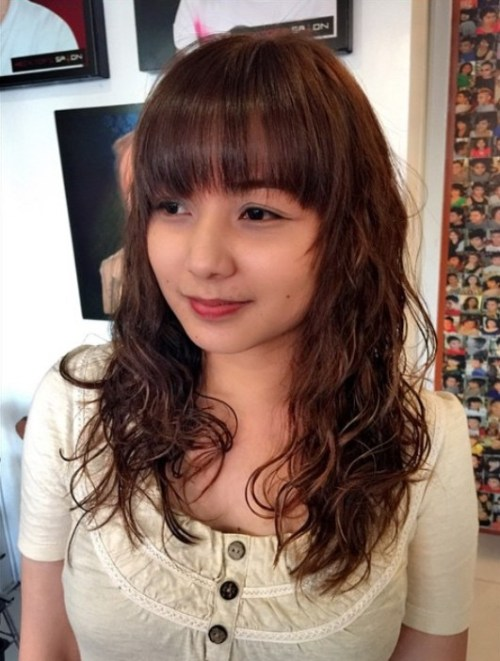perms hairstyles - permed long brunette hairstyle with bangs