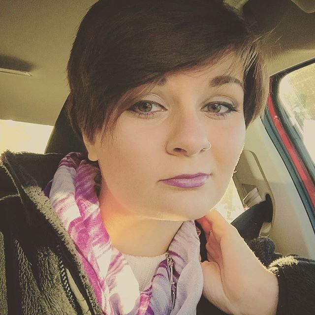 short pixie cut with long bangs for round faces