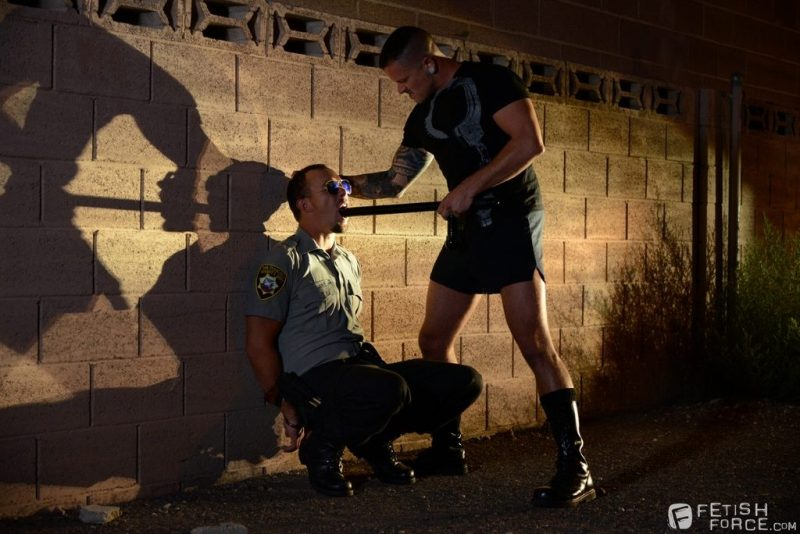 locking officer Kirk Cummings up with handcuffs 02
