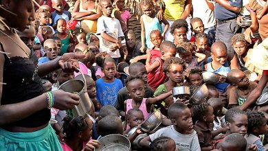 Crowd of kids waiting for food