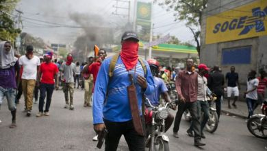 Armed off duty police officers protest over police pay and working conditions in Port au Prince