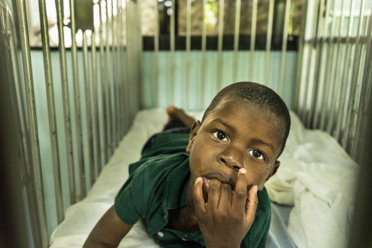 A boy who is handicap in his crib in the orphanage in Zanmi Lasante, Haiti, May 2015 [Photo by: Mary Margaret Johnson]