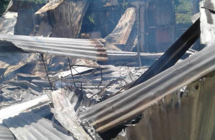 Marchand Dessalines: les gangs Arnel et Ti Sourit s'affrontent, un mort, 25 maisons incendiées