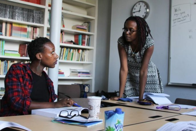 Ayanna Legros receiving instruction from Professor Wynnie Lamour. Photo credit: Maya Earls