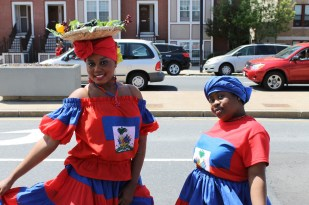 Huguettia Eusebe 20, of Mattapan dressed in national colors and a traditional straw hat honoring Haiti's agricultural history. Photo Credit: Gage Norris