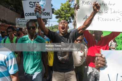 Demonstrators take to the streets in Port-Au-Prince, December 5, 2017, to demonstrate against corruption.Several civil society organizations took part in a march against corruption Tuesday, December 5, 2017. The initiative was taken by the Collective December 4, a human rights organization.