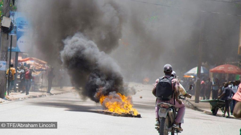 Politician throw rocks at police, triggering tear gas blast