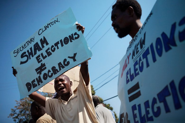 clintons, haiti policies, Clinton and Michel Martelly, haiti elections Martelly