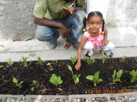 adama makung sure her picture gets taken. planting without looking :-)