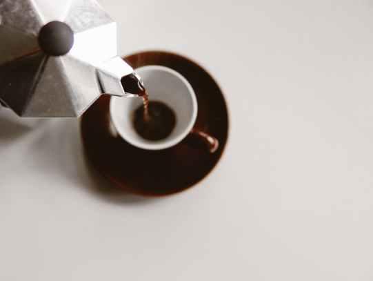 fresh hot coffee prepared with machine