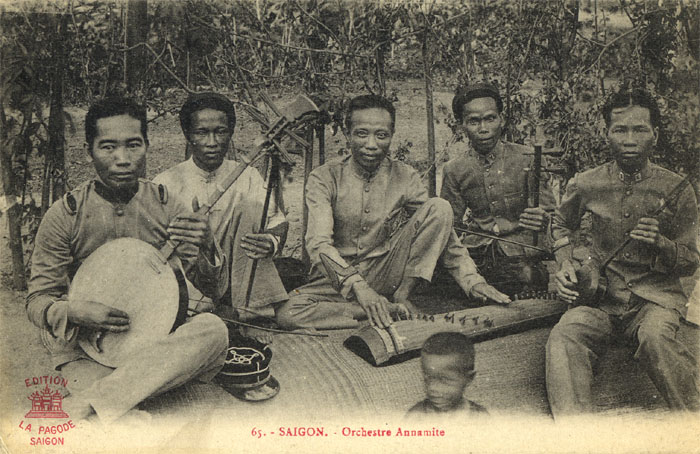 L to R; another raised fret instrument is the Dan Nguyet (in the south called Dan Kim), a bowed Dan Nhi, the Vietnamese zither called Dan Tranh, I can't quite make out the next fiddle, but I think it's a Dan Gao, and finally the Dan Tam, related to the Chinese sanxian.