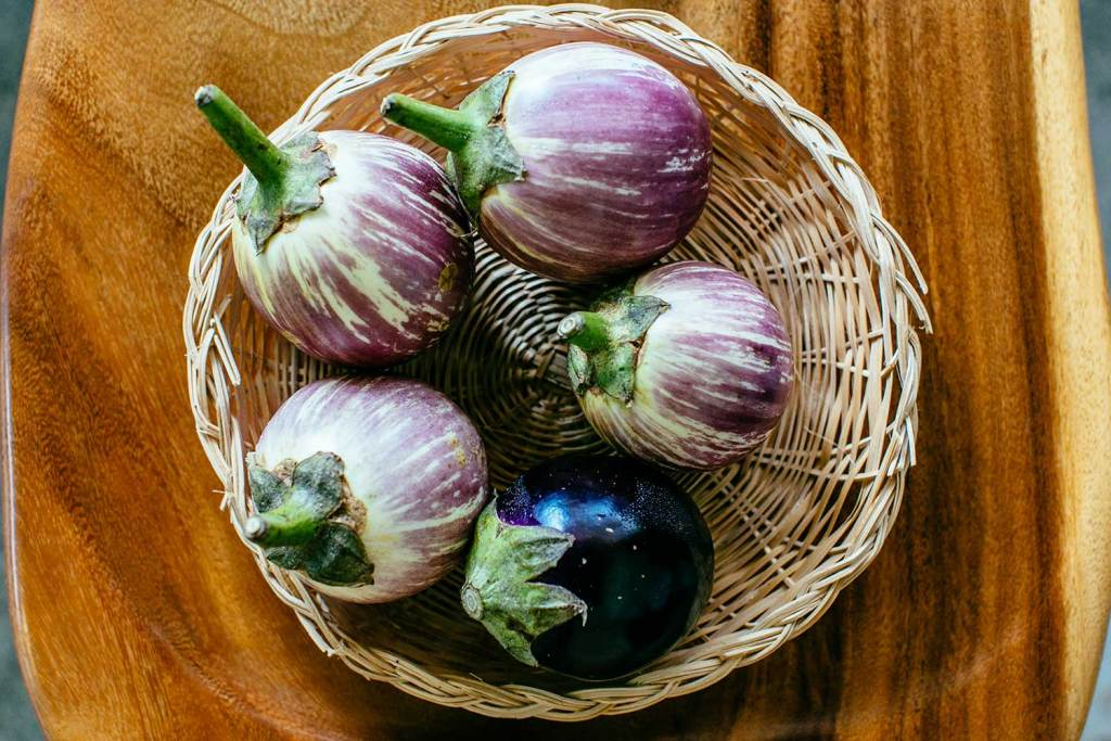 basket of eggplants on table