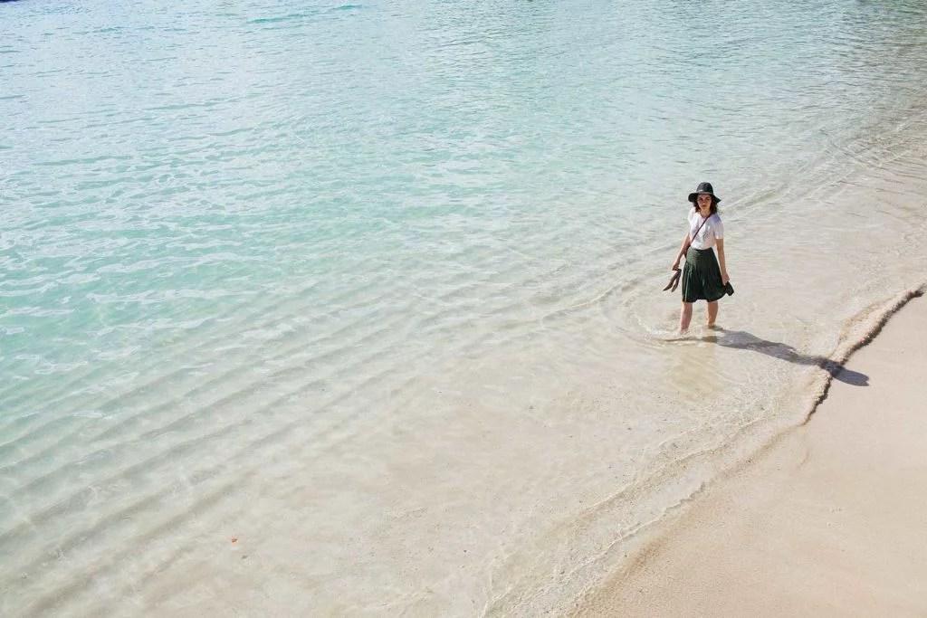woman standing on shoreline of Waikiki Beach