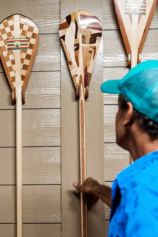 Leleo Kinimaka with three inlay wood paddles
