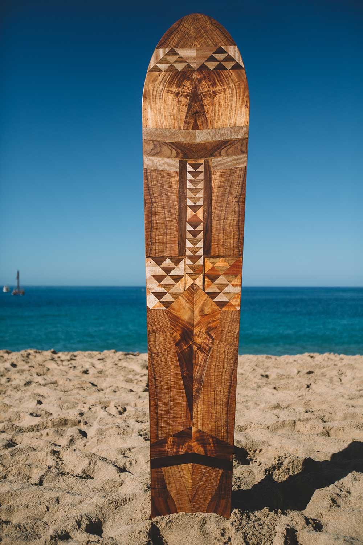 intricate wooden Hawaiian surfboard