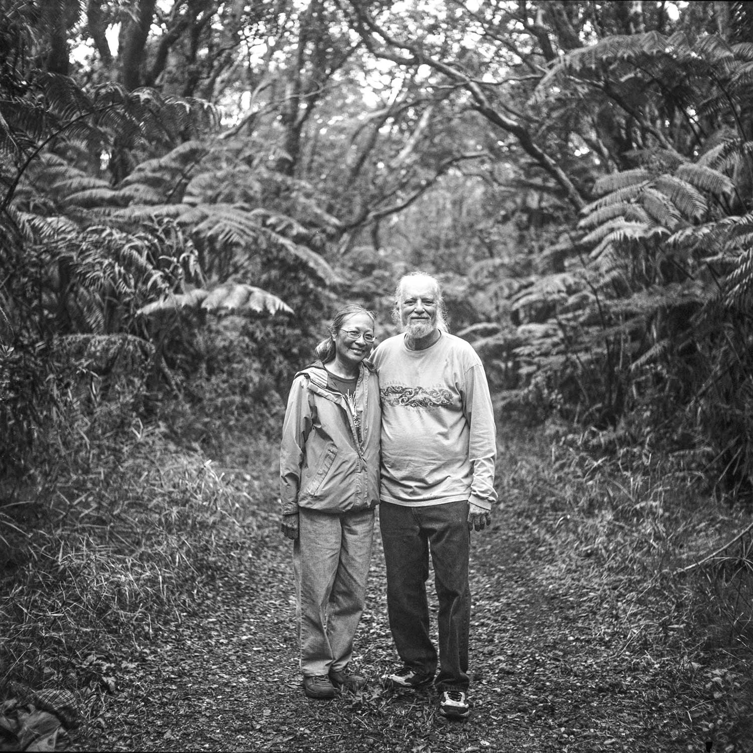 black and white photo of Howard Shapiro and wife Marsha Hee standing in forest