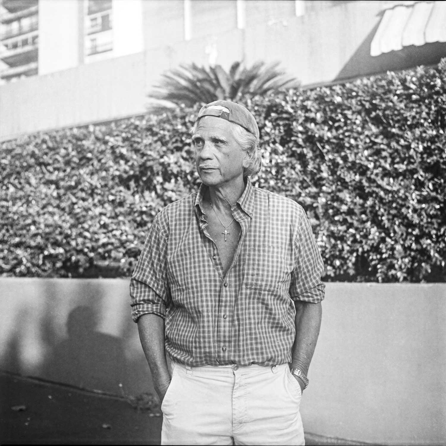 black and white photo of Kirk Thompson with hands in pockets of pants