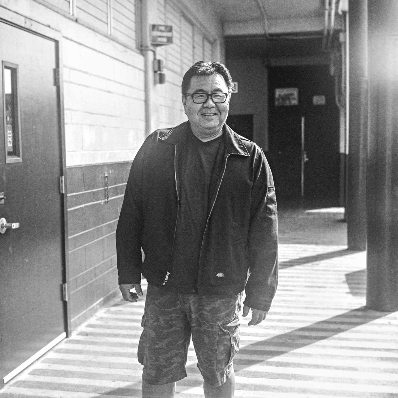 black and white photo of Ward Yamashita standing near building